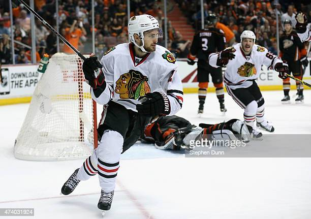 Marcus Kruger of the Chicago Blackhawks celebrates scoring the game winning goal against goaltender Frederik Andersen of the Anaheim Ducks in triple...