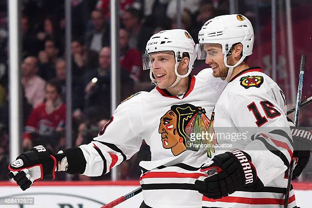 Marcus Kruger of the Chicago Blackhawks celebrates with Kris Versteeg after scoring a goal against Montreal Canadiens in the NHL game at the Bell...