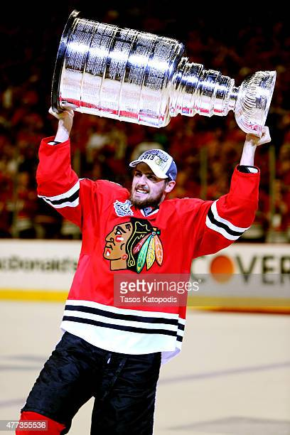 Marcus Kruger of the Chicago Blackhawks celebrates with the Stanley Cup after defeating the Tampa Bay Lightning by a score of 2-0 in Game Six to win...