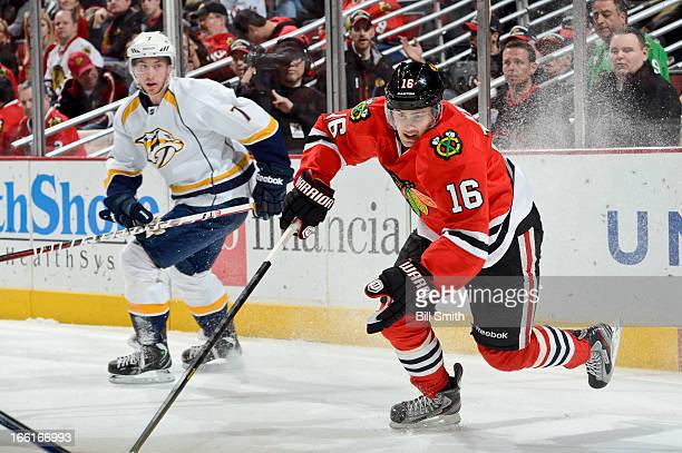 Marcus Kruger of the Chicago Blackhawks chases after the puck as Jonathon Blum of the Nashville Predators skates behind during the NHL game on April...