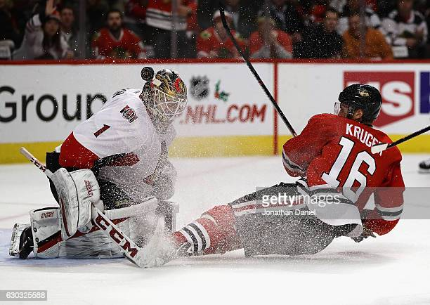 Marcus Kruger of the Chicago Blackhawks crashes into Mike Condon of the Ottawa Senators after taking a shot at the United Center on December 20 2016...
