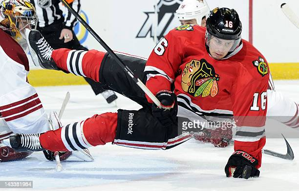 Marcus Kruger of the Chicago Blackhawks falls to the ice during Game Four of the Western Conference Quarterfinals against the Phoenix Coyotes during...