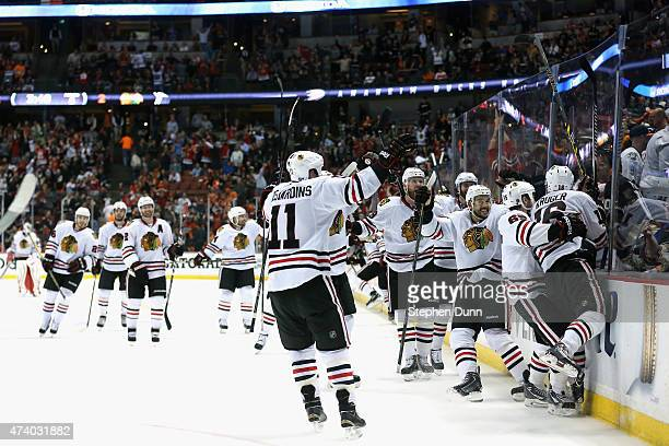 Marcus Kruger of the Chicago Blackhawks is congratulated by teammates after he scored the game winning goal over the Anaheim Ducks in triple overtime...