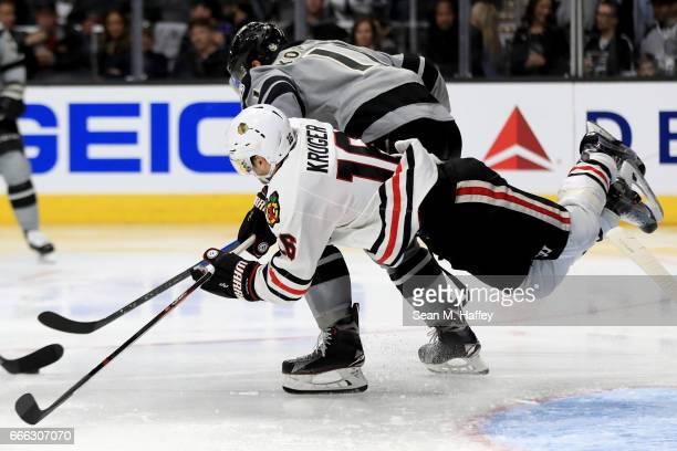Marcus Kruger of the Chicago Blackhawks is tripped as Anze Kopitar of the Los Angeles Kings skates past during the third period of a game at Staples...
