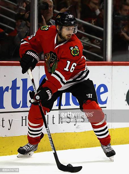 Marcus Kruger of the Chicago Blackhawks looks to pass against the Ottawa Senators at the United Center on December 20 2016 in Chicago Illinois The...