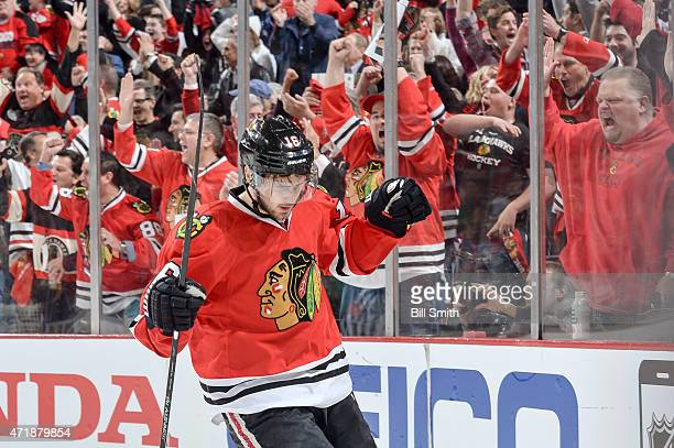 Marcus Kruger of the Chicago Blackhawks reacts after scoring the third goal in the first period against the Minnesota Wild in Game One of the Western...