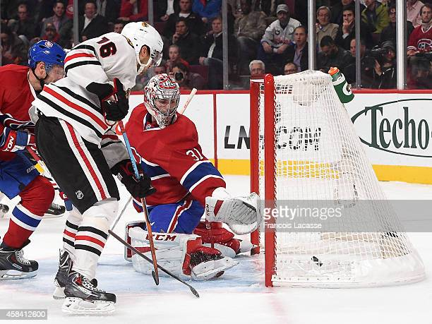 Marcus Kruger of the Chicago Blackhawks scores a goal against the Montreal Canadiens in the NHL game at the Bell Centre on November 4, 2014 in...