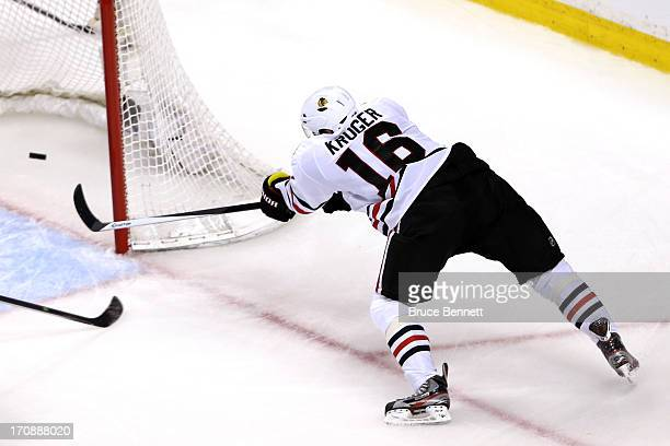 Marcus Kruger of the Chicago Blackhawks scores a goal in the second period against the Boston Bruins in Game Four of the 2013 NHL Stanley Cup Final...