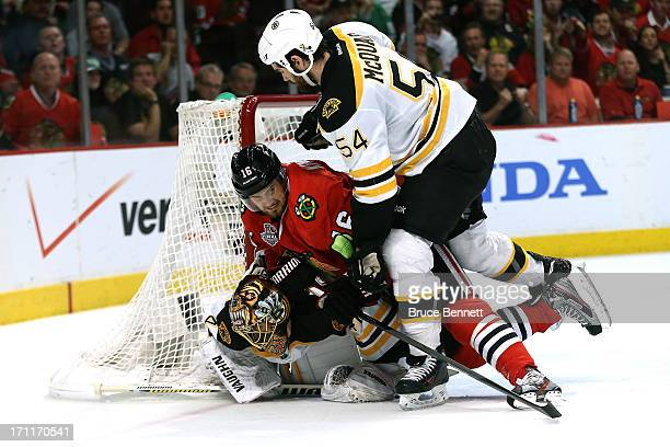 Marcus Kruger of the Chicago Blackhawks trips over Tuukka Rask of the Boston Bruins in the net during Game Five of the 2013 NHL Stanley Cup Final at...