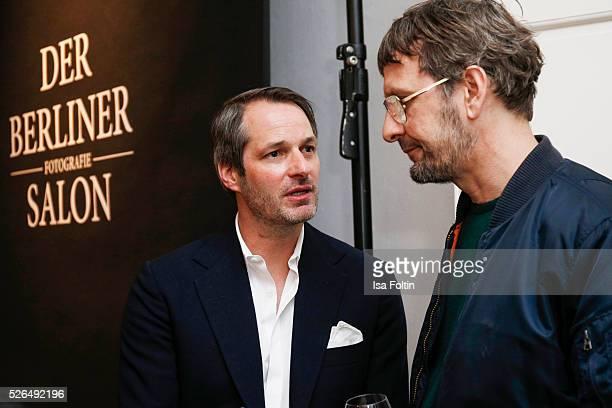 Marcus Kurz cofounder of the Berliner Modesalon and artist Daniel Richter at 'Der Berliner Fotografie Salon Edition 1' on April 29 2016 in Berlin...