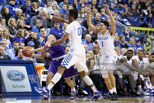 Marcus Lee and Devin Booker of the Kentucky Wildcats defend Sam Daly of the Grand Canyon Antelopes at Rupp Arena on November 14 2014 in Lexington...