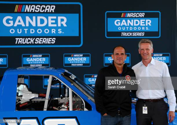 Marcus Lemonis Chairman of Gander Outdoors Camping World and Overton's and NASCAR Chief Operating Officer Steve Phelps pose for a photo during a...