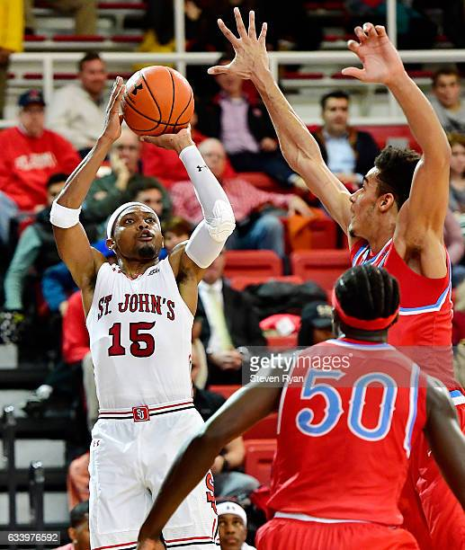 Marcus LoVett of the St John's Red Storm attempts a shot against the Delaware State Hornets during the second half at Carnesecca Arena on November 29...