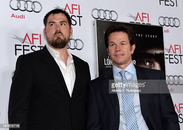 Marcus Luttrell and actor Mark Wahlberg attend the premiere for Lone Survivor during AFI FEST 2013 presented by Audi at TCL Chinese Theatre on...