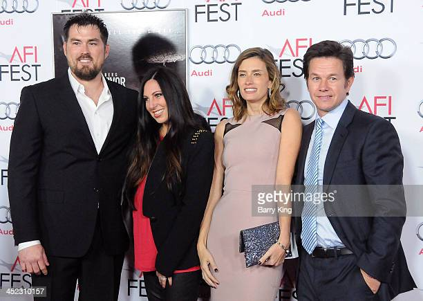 Marcus Luttrell and his wife Melanie Juneau Luttrell Rhea Durham and husband actor Mark Wahlberg attend the screening of 'Lone Survivor' at AFI FEST...