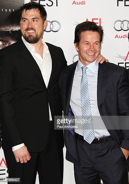 Marcus Luttrell and Mark Wahlberg attend the screening of Lone Survivor at AFI FEST 2013 at the TCL Chinese Theatre on November 12 2013 in Hollywood...