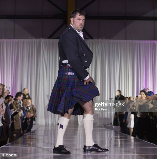 Marcus Luttrell walks the runway during 'Dressed to Kilt' at Million Air Houston on April 7 2018 in Houston Texas