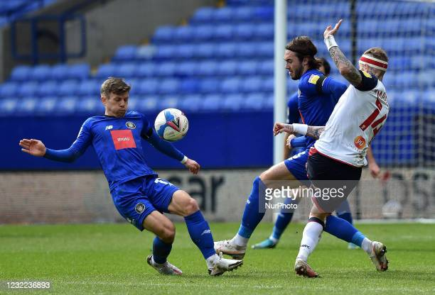 Marcus Maddison of Bolton Wanderers tussles with Lloyd Kerry of Harrogate Town and Dan Jones of Harrogate Town during the Sky Bet League 2 match...
