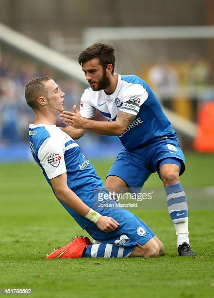 Marcus Maddison of Peterborough celebrates with Jack Payne after he scores to make it 10 during the Sky Bet League One match between Peterborough...