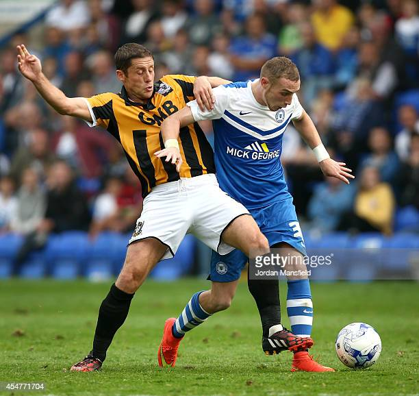 Marcus Maddison of Peterborough tackles with Michael Brown of Port Vale during the Sky Bet League One match between Peterborough United and Port Vale...