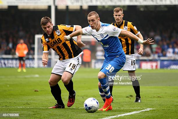 Marcus Maddison of Peterborough takes the ball past Steven Jennings of Port Vale during the Sky Bet League One match between Peterborough United and...