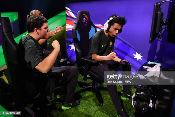 Marcus 'Marcus Gomes' Gomes of Australia celebrates with team mates Mark 'Marko' Brijeski of Australia after scoring in his Round 1 match in Group D...