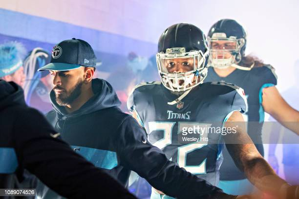 Marcus Mariota and Derrick Henry of the Tennessee Titans walks through a tunnel of fans before a game against the Indianapolis Colts at Nissan...