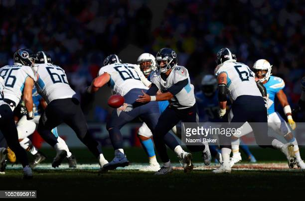 Marcus Mariota of Tennessee Titans passes the ball during the NFL International Series match between Tennessee Titans and Los Angeles Chargers at...