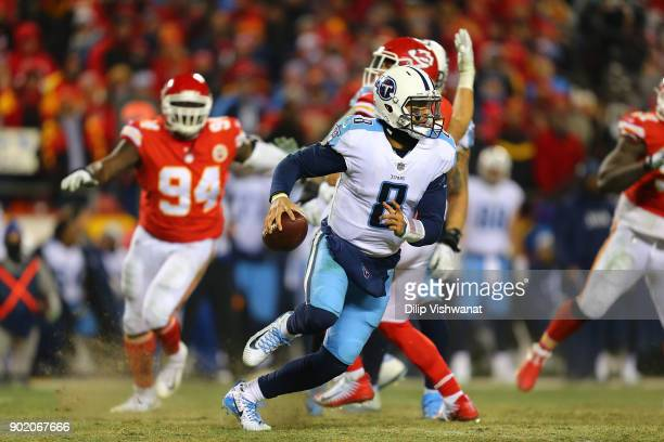 Marcus Mariota of the Tennessee Titans avoids being sacked against the Kansas City Chiefs during the AFC Wild Card playoff game at Arrowhead Stadium...