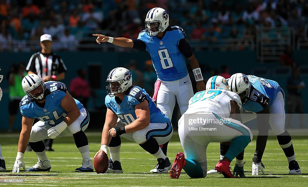 Marcus Mariota #8 of the Tennessee Titans calls a play during a game against the Miami Dolphins on October 9, 2016 in Miami Gardens, Florida.