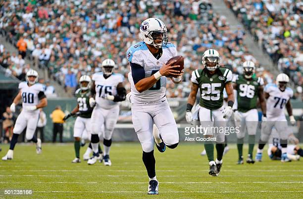 Marcus Mariota of the Tennessee Titans completes a pass from Antonio Andrews for a touchdown in the third quarter against the New York Jets during...