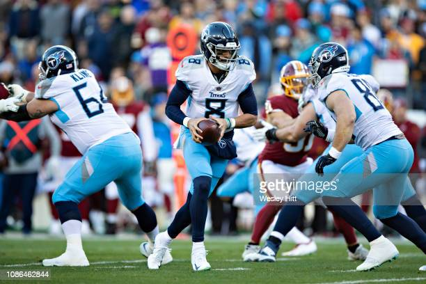 Marcus Mariota of the Tennessee Titans drops back to make a handoff during a game against the Washington Redskins at Nissan Stadium on December 22...