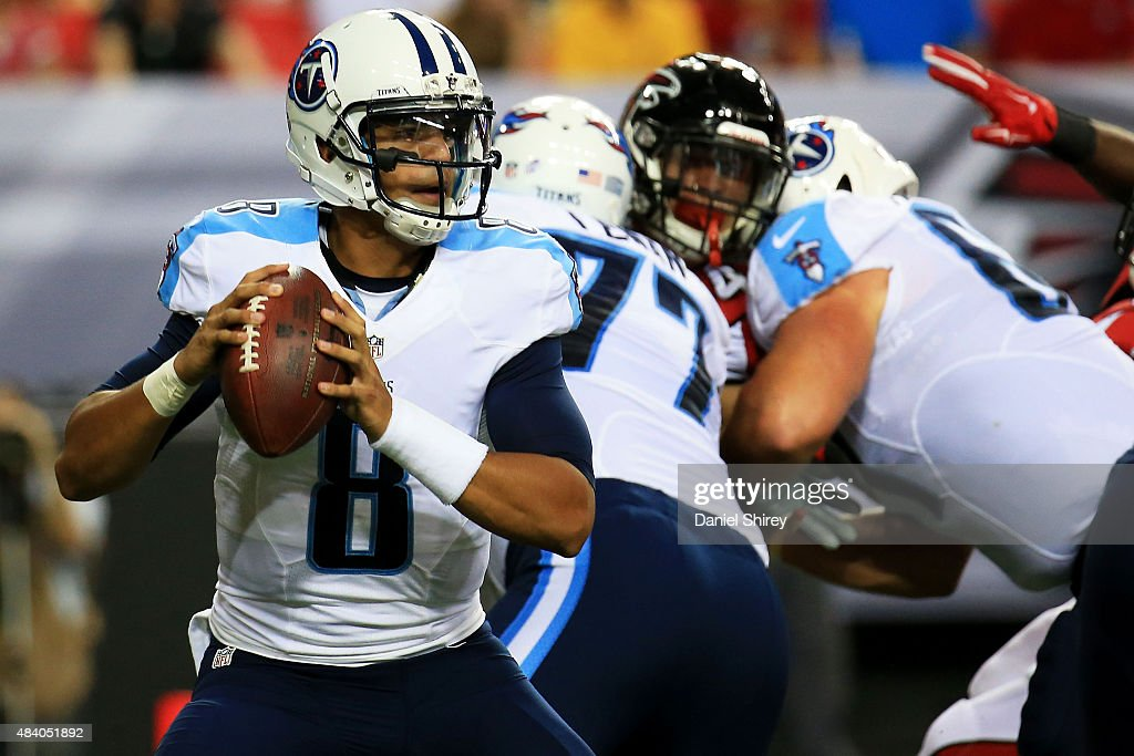 Marcus Mariota #8 of the Tennessee Titans drops back to pass in the first half of a preseason game against the Atlanta Falcons at the Georgia Dome on August 14, 2015 in Atlanta, Georgia.