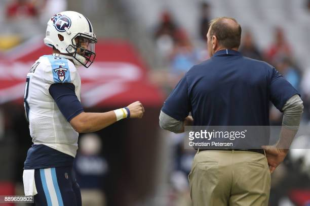 Marcus Mariota of the Tennessee Titans fist bumps head coach Mike Mularkey prior to the NFL game against the Arizona Cardinals at University of...