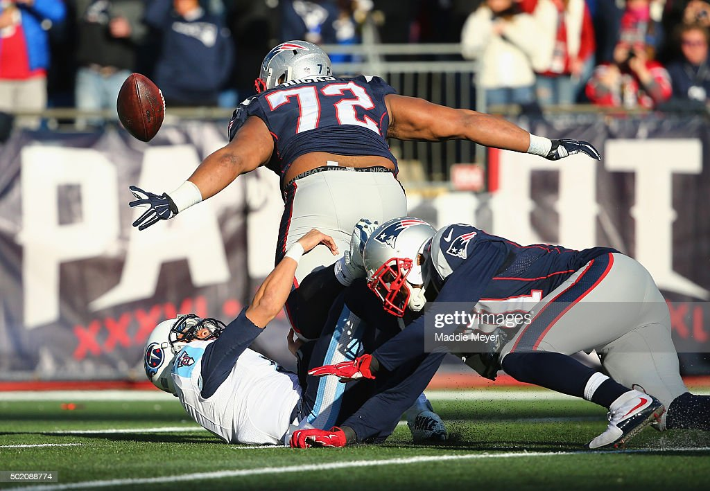 Marcus Mariota #8 of the Tennessee Titans fumbles the football during the second quarter leading to a touchdown by Akiem Hicks #72 of the New England Patriots at Gillette Stadium on December 20, 2015 in Foxboro, Massachusetts.