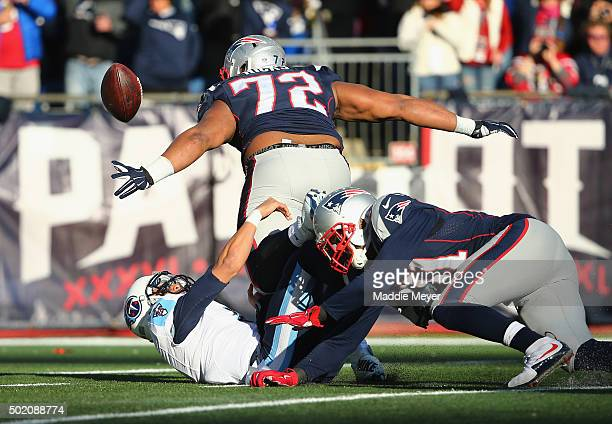 Marcus Mariota of the Tennessee Titans fumbles the football during the second quarter leading to a touchdown by Akiem Hicks of the New England...