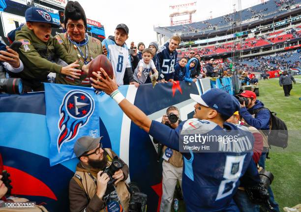 Marcus Mariota of the Tennessee Titans gives the game ball to a fan after the game against the New England Patriots at Nissan Stadium on November 11...