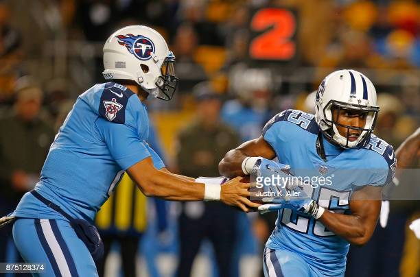 Marcus Mariota of the Tennessee Titans hands the ball off to Adoree' Jackson in the first half during the game against the Pittsburgh Steelers at...