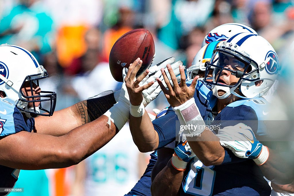 Marcus Mariota #8 of the Tennessee Titans has the ball knocked loose while trying to throw a pass against the Miami Dolphins at LP Field on October 18, 2015 in Nashville, Tennessee. The Dolphins defeated the Titans 38-10.