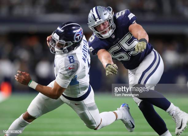 Marcus Mariota of the Tennessee Titans is pursued byLeighton Vander Esch of the Dallas Cowboys in the fourth quarter of a football game at ATT...