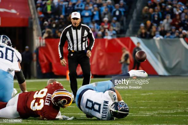 Marcus Mariota of the Tennessee Titans is sacked by Jonathan Allen of the Washington Redskins during the second quarter at Nissan Stadium on December...