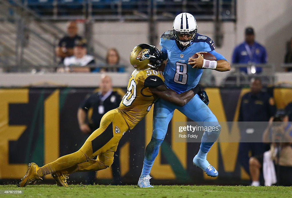 Marcus Mariota #8 of the Tennessee Titans is sacked by Telvin Smith #50 of the Jacksonville Jaguars during the second half of the game at EverBank Field on November 19, 2015 in Jacksonville, Florida.