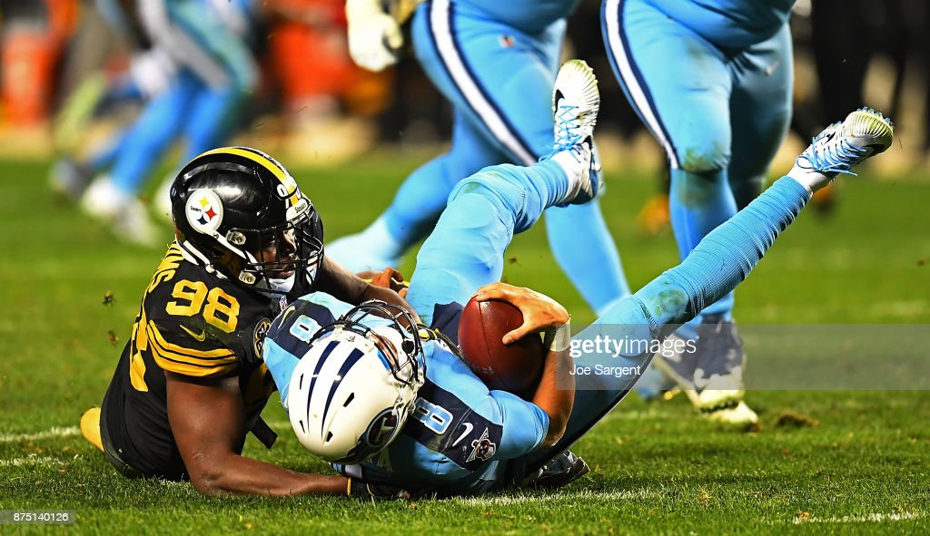 Marcus Mariota #8 of the Tennessee Titans is sacked by Vince Williams #98 of the Pittsburgh Steelers in the second half during the game at Heinz Field on November 16, 2017 in Pittsburgh, Pennsylvania.