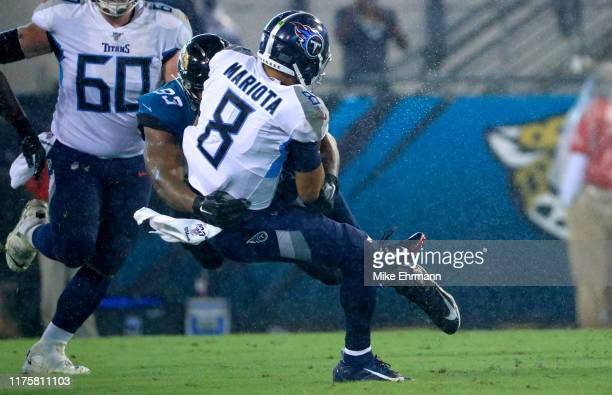 Marcus Mariota of the Tennessee Titans is tackled by Calais Campbell of the Jacksonville Jaguars during a game at TIAA Bank Field on September 19...