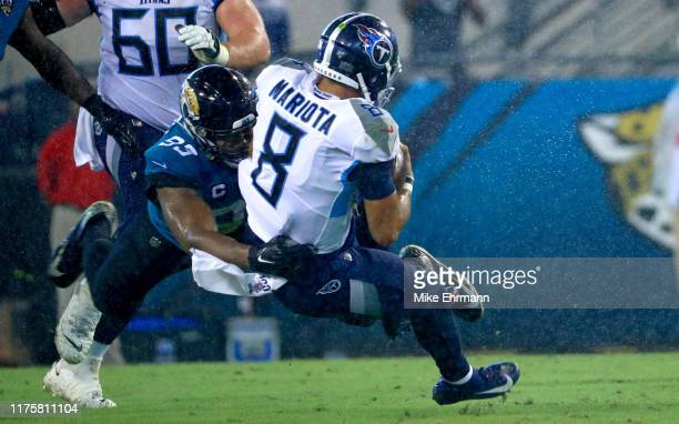 Marcus Mariota of the Tennessee Titans is tackled by Calais Campbell of the Jacksonville Jaguars during a game at TIAA Bank Field on September 19,...