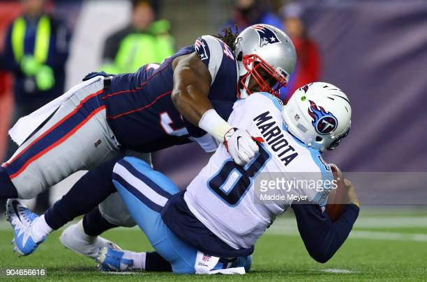 Marcus Mariota of the Tennessee Titans is tackled by Ricky Jean Francois of the New England Patriots during the fourth quarter in the AFC Divisional...