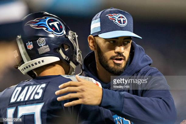 Marcus Mariota of the Tennessee Titans on the field while the team warms up before a game against the Indianapolis Colts at Nissan Stadium on...
