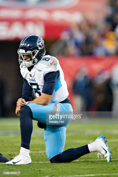 Marcus Mariota of the Tennessee Titans rests on one knee after a hard tackle during a game against the Washington Redskins at Nissan Stadium on...