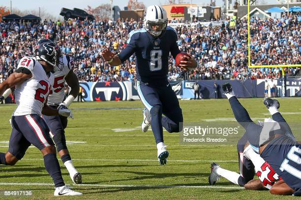 Marcus Mariota of the Tennessee Titans runs into the end zone for a touchdown against the Houston Texans during the first half at Nissan Stadium on...