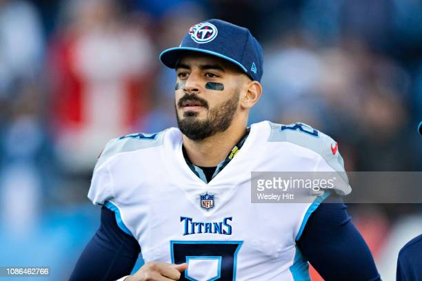 Marcus Mariota of the Tennessee Titans runs onto the field through the tunnel before a game against the Washington Redskins at Nissan Stadium on...